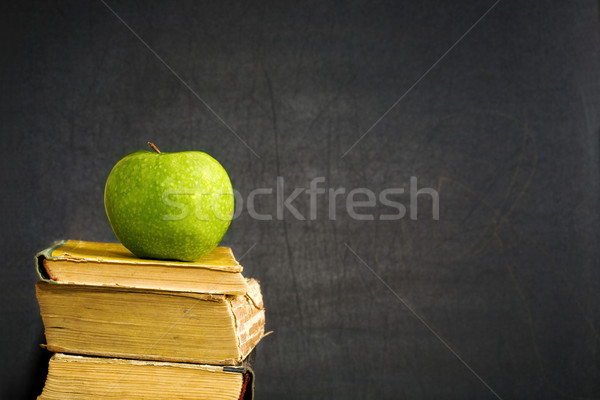 Green apple on textbook Stock photo © Yaruta