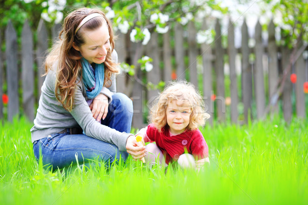 Woman and child in summer garden Stock photo © Yaruta