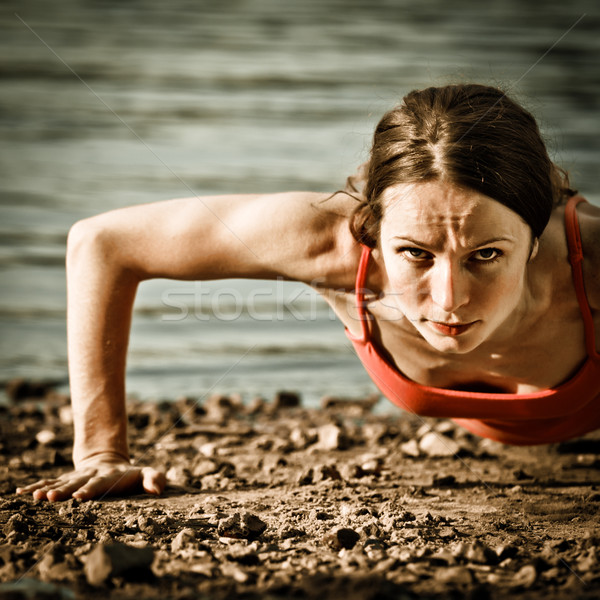 Strong woman doing pushup Stock photo © Yaruta