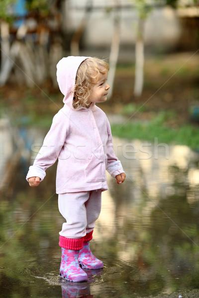Lluvia cute nino charco Foto stock © Yaruta