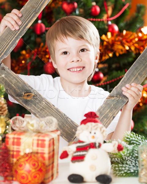 Spelen christmas lichten familie gezicht Stockfoto © Yaruta