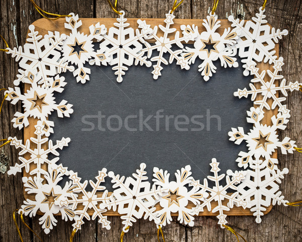 Blackboard blank framed in wooden snowflakes Stock photo © Yaruta