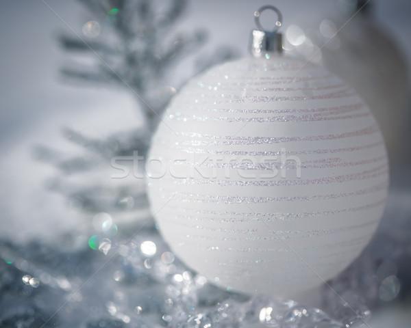 Silver Christmas tree decorations on snow Stock photo © Yaruta