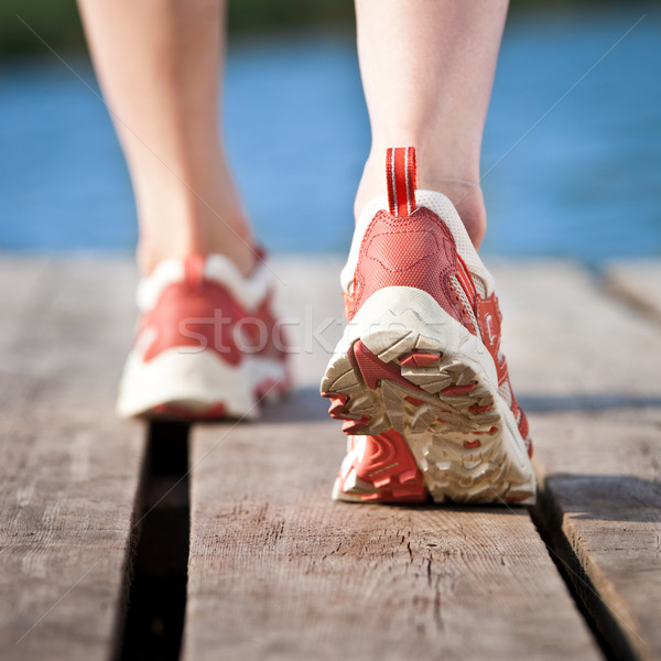 Feet of jogging person Stock photo © Yaruta