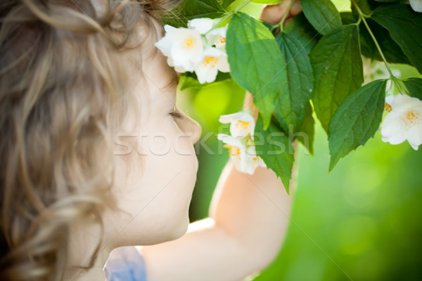Child with jasmin flower Stock photo © Yaruta