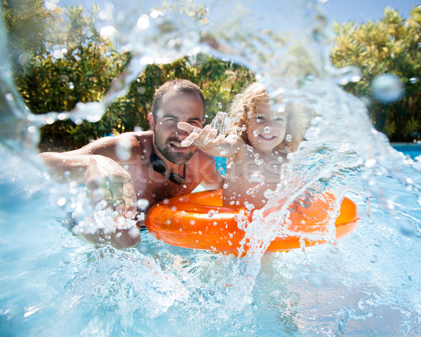 Child with father in swimming pool Stock photo © Yaruta