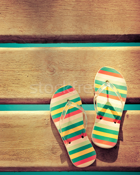 Beach flip flops on wood Stock photo © Yaruta