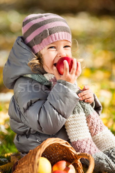 Stock photo: Child eating red apple