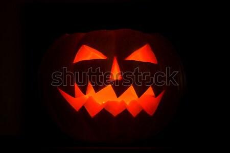 Scary halloween pumpkins jack-o-lantern candle lit Stock photo © Yaruta