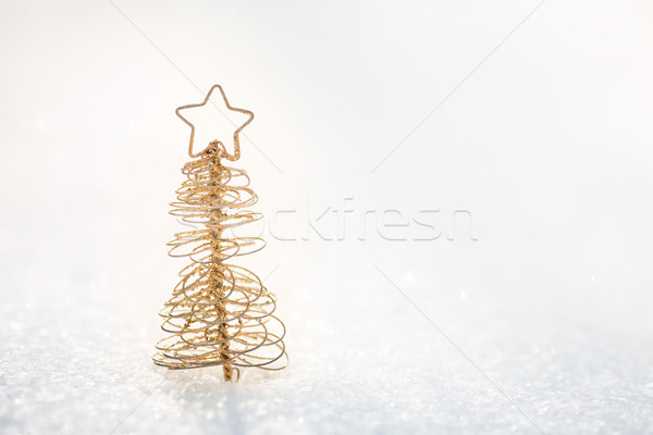 Gold Christmas tree decoration on snow Stock photo © Yaruta