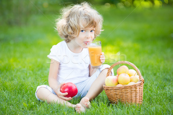 Child drinking apple juice Stock photo © Yaruta