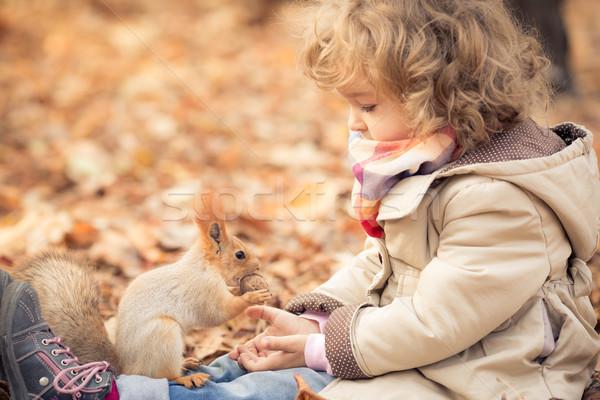 Gyermek kicsi mókus boldog ősz park Stock fotó © Yaruta