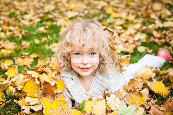 Stock photo: Child lying on autumn leaves