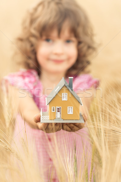 Child holding house in hands Stock photo © Yaruta