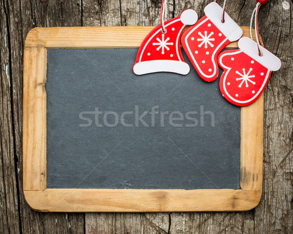 Christmas tree decorations on vintage wooden blackboard Stock photo © Yaruta