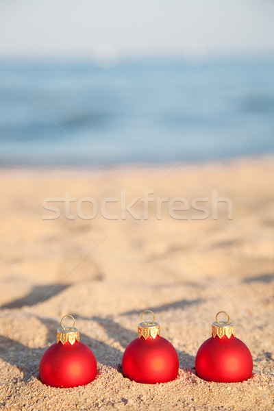 Christmas balls on sea coast Stock photo © Yaruta