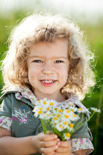 Stock photo: Child with bunch of spring flowers