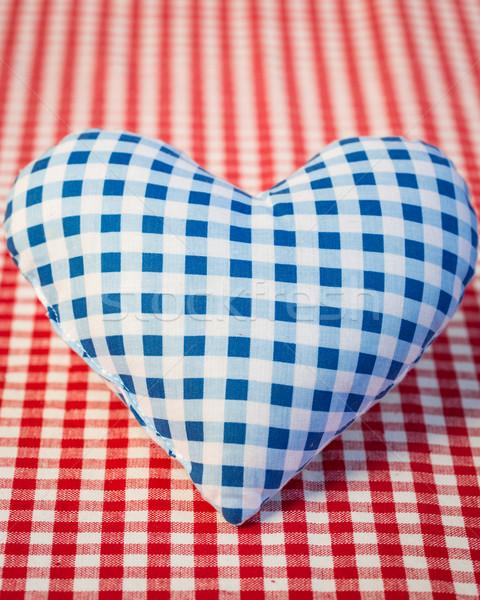 Blue heart on gingham tablecloth Stock photo © Yaruta