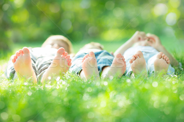 Family lying on green grass Stock photo © Yaruta
