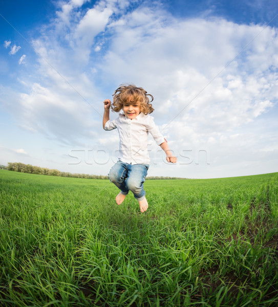 Happy kid jumping Stock photo © Yaruta