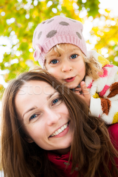 Woman with child in autumn Stock photo © Yaruta