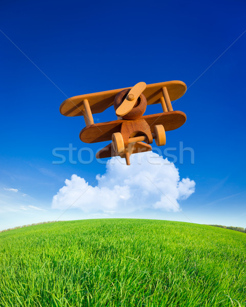 Houten speelgoed vliegtuig vliegen zomer blauwe hemel Stockfoto © Yaruta