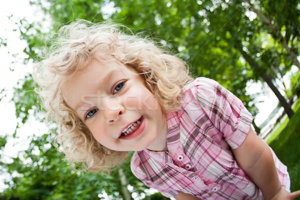 Portré mosolyog gyermek alulról fotózva kilátás áll Stock fotó © Yaruta