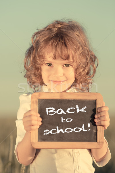 Schoolchild holding small blackboard Stock photo © Yaruta