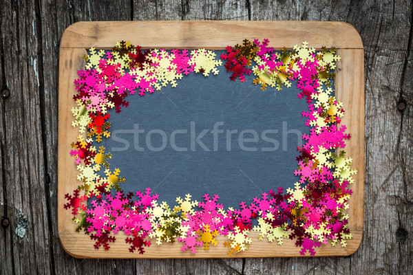 Christmas frame of confetti on blackboard Stock photo © Yaruta