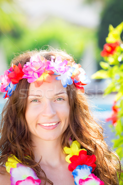 Woman wearing hawaiian flowers garland Stock photo © Yaruta