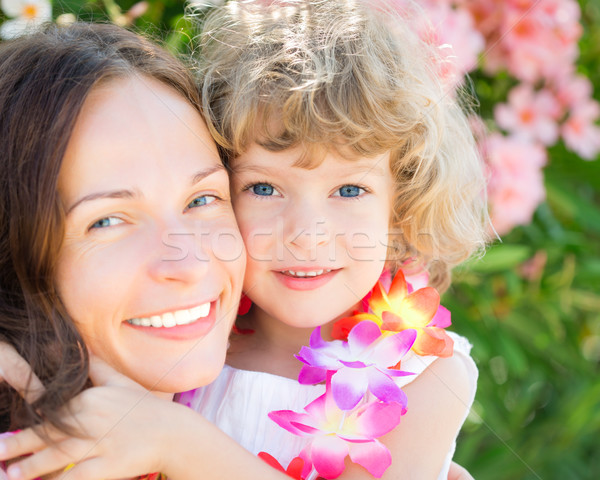Happy child embraced your mother Stock photo © Yaruta