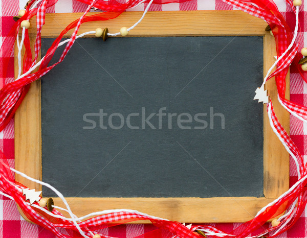 Blackboard blank framed in red Christmas decorations Stock photo © Yaruta
