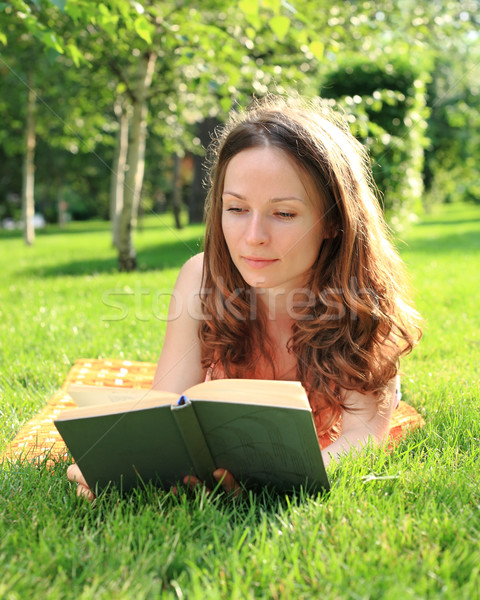 Woman reading book Stock photo © Yaruta