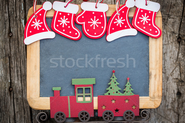 Christmas tree decorations border on vintage wooden blackboard Stock photo © Yaruta