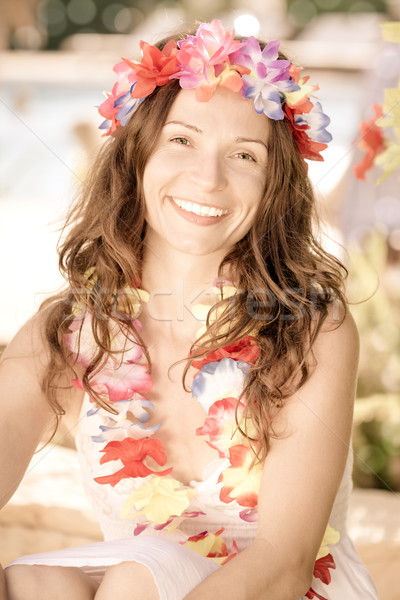 Woman wearing hawaiian flowers garland Stock photo © Yaruta