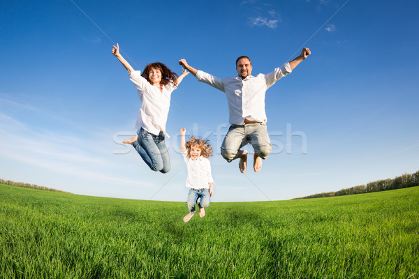 Happy family jumping Stock photo © Yaruta