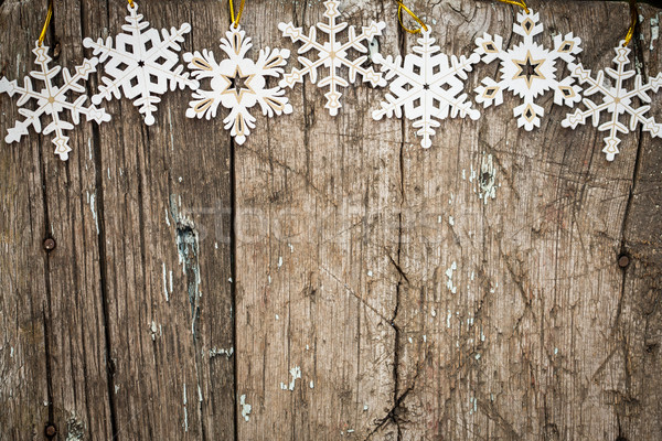 Snowflakes border on wood Stock photo © Yaruta