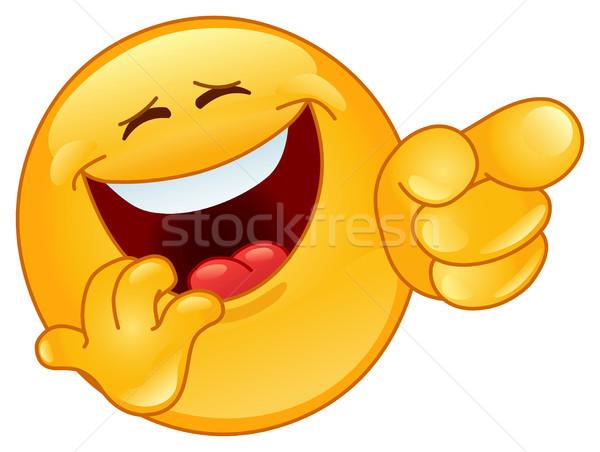 смеясь указывая смайлик стороны улыбка лице Сток-фото © yayayoyo