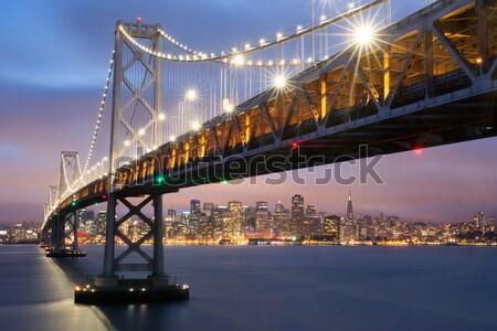 Akşam karanlığı köprü San Francisco ufuk çizgisi Kaliforniya görmek Stok fotoğraf © yhelfman