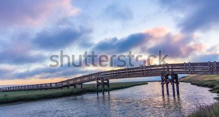 Sunset views of footbridge crossing salt evaporation pond in Don Edwards San Francisco Bay National  Stock photo © yhelfman