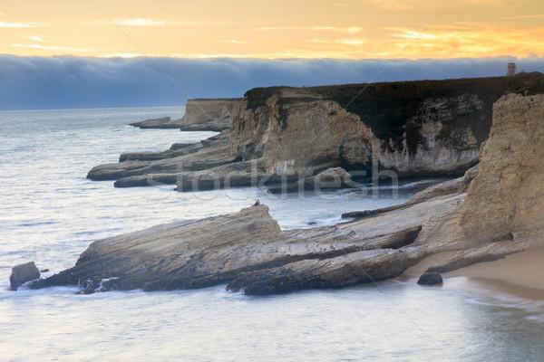 Foggy Sunset Coastline. Stock photo © yhelfman