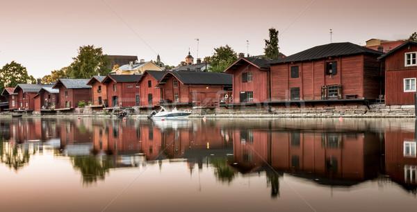 Piros part házak folyópart folyó naplemente Stock fotó © yhelfman