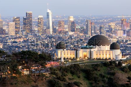 Stock photo: Griffith Observatory Park with Los Angeles Skyline at Dusk.
