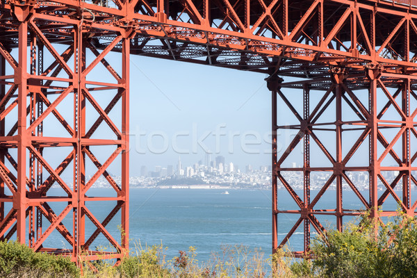 San Francisco Downtown in Hazy Summer Framed by the Golden Gate Bridge. Stock photo © yhelfman