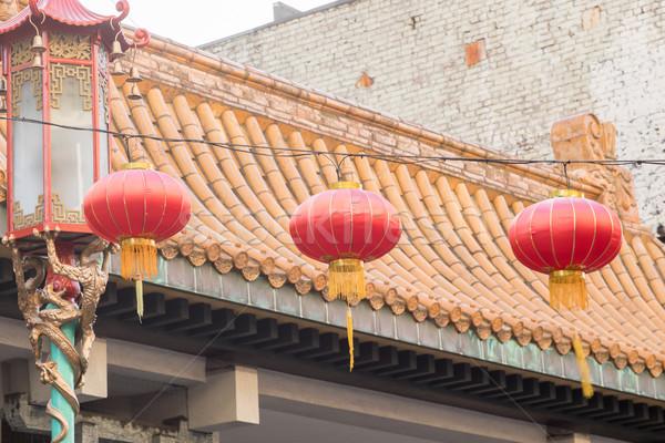 Red Chinese Lanterns against Chinese Pagoda Stock photo © yhelfman