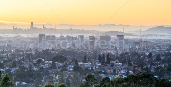 Sunset over Oakland and San Francisco Hazy Skylines. Stock photo © yhelfman