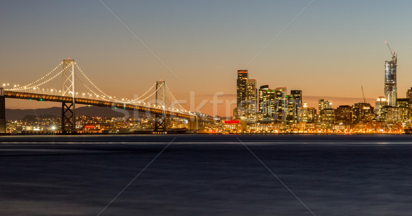 San Francisco's Bay Bridge and City Lights Stock photo © yhelfman