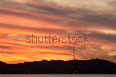 Sutro Tower Sunset as seen from Port of Oakland. Stock photo © yhelfman