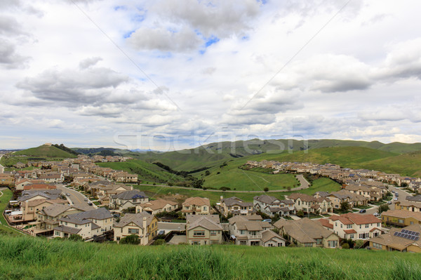 Residential Homes in Dublin Hills with approaching storm clouds in the winter. Stock photo © yhelfman