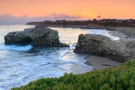 Sunset over Natural Bridges State Beach. Stock photo © yhelfman